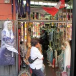 In downtown Lima, there are many shops that sell candles and other items used for woship.