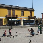 Families enjoying the sunshine in front of San Francisco church during Peru's Labor Day.