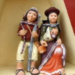 Ceramic figures welcome visitors in Chinchero.