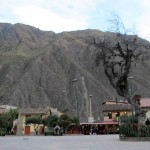 The town square is surrounded by mountains on all sides.