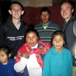 Michael, left, and David with their host family in Lucre.