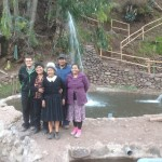 Alberto with his host mother, host grandmother, and host aunt and uncle by a trout pool.
