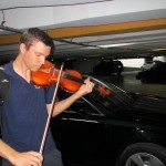Peter tests out his new, made in China, violin in an underground parking garage in Lima.