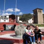 In the central plaza of Curahuasi, with a replica of the Saywite stone.