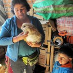 Nieves shows one of the family's rabbits.