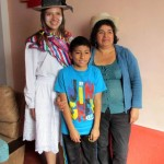 Morgan with her host mother, Nieves, and brother, Javier. Nieves wanted Morgan to try on a traditional dance costume.