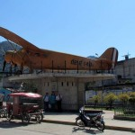A small plane on display near the center of town celebrates the first flight from Lima to San  Ramón.