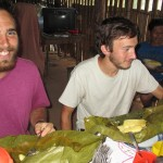 Zach and David dig into a delicious lunch of chicken and yuca wrapped in flavorful leaves.