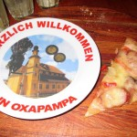 A plate at the pizza parlor hints at the Austrio-German background of Oxapampa.