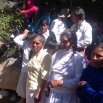 Irene and her mother with several of the villagers who were baptized during the weekend.
