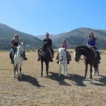 Kate, Asia, Wanda and Morgan on horses near the site where the Battle of Ayacucho took place.