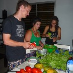Patrick, Erin, and Alysha cut vegetables