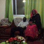 John's father Cheikh M'Baye and mother