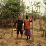 Clayton with father in manioc field