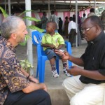 Ryan talking with Rev. John Wambura at Sinza Mennonite