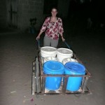 Photo by Anna: helping bring water to the house