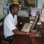 Alain working in the Mogabiri Farm Extension office