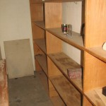 The now empty closet shelves