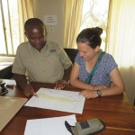Ellie with Philemon in the Grumeti Research/Monitoring office.