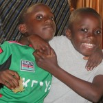 Isaac with Machota, a young boy who lives with Neema.