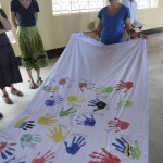 Each student made their hand-print on a wall hanging